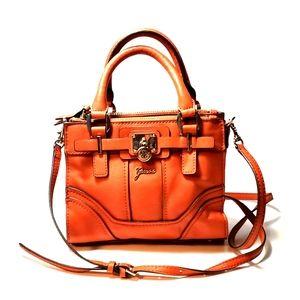 Guess Orange crossbody purse.